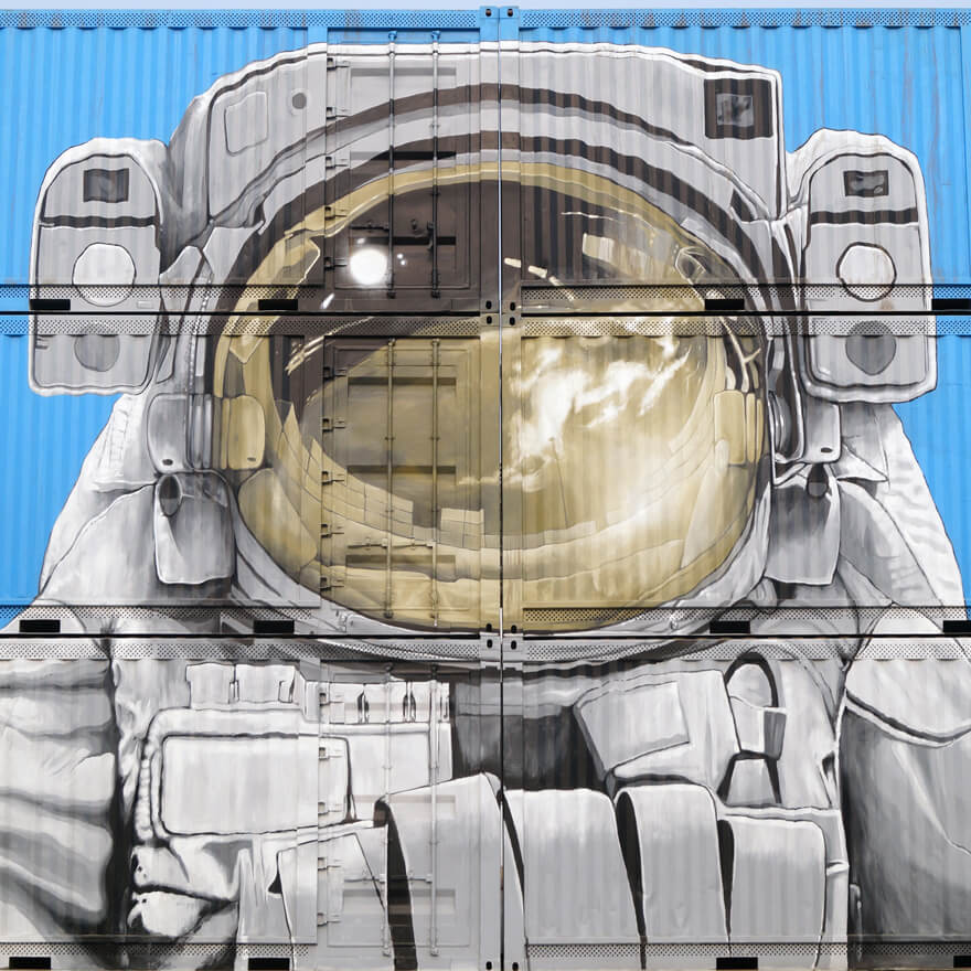 An astronaut street art painted on containers