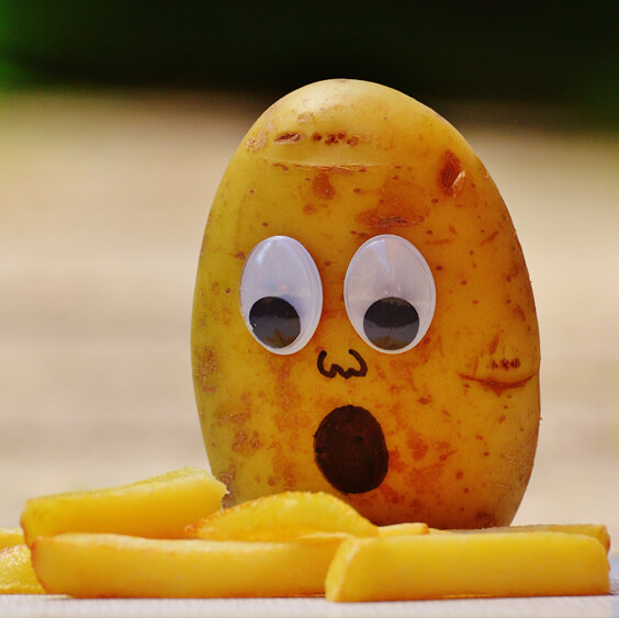 A surprised potato looking at the french fries